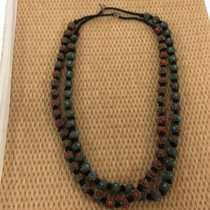 Exotic black cord and bean necklace